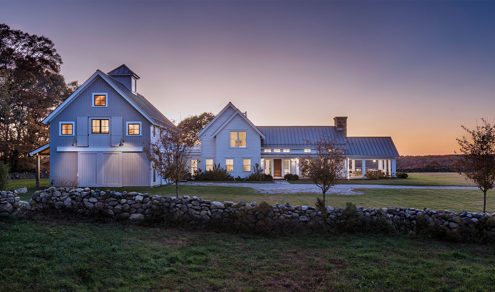 contemporary waterfront farmhouse and barn