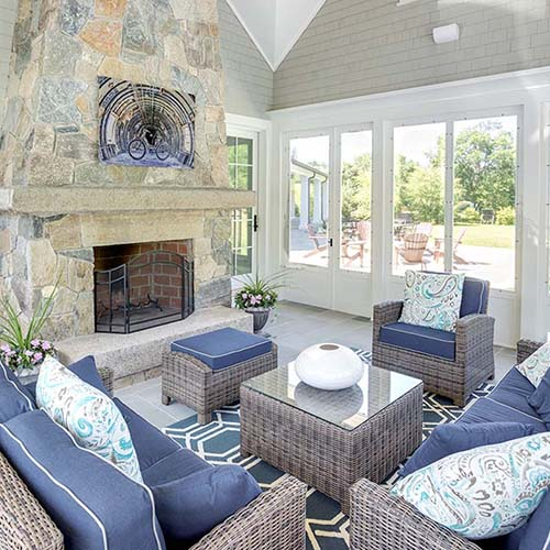 sunroom with a fireplace